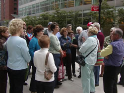 Joyce Gold guiding a tour in battery park.