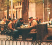 Men playing chess in Washington Square Park in NYC.